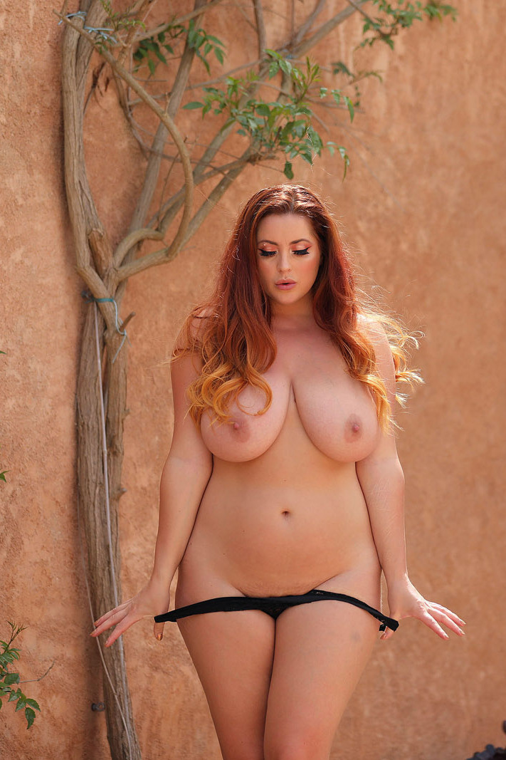 Lucy Vixen strips topless in Nothing-But-Curves photoshoot