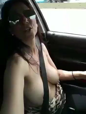 busty woman with big nipples drives topless