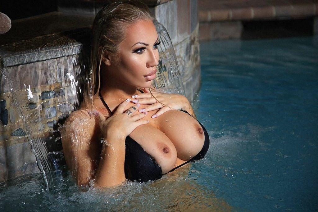 Jessie jensen flaunts her nipples in bikini
