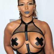 Busty Sundy Carter leaves nothing to the imagination in bondage outfit!