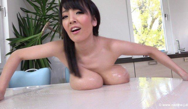 Busty Japanese pornstar Hitomi-Tanaka topless