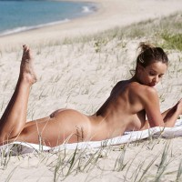 Kahili Blundel naked on the beach