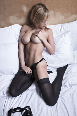 Sexy woman topless hot body on bed