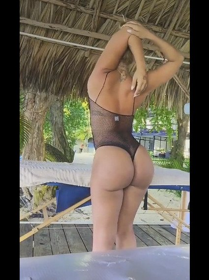 sexy girl with insane ass in thong fishnet bodysuit